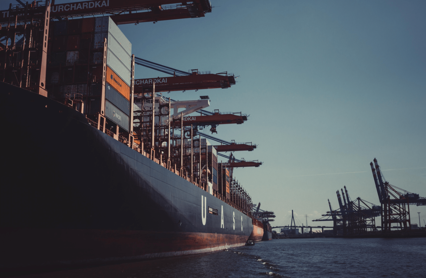 A freighter ship with shipping containers